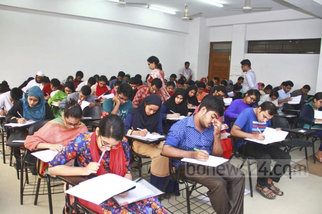 Students take tests for admission to medical colleges at a centre on Friday. As many as 66,000 students are taking part in the tests this year.