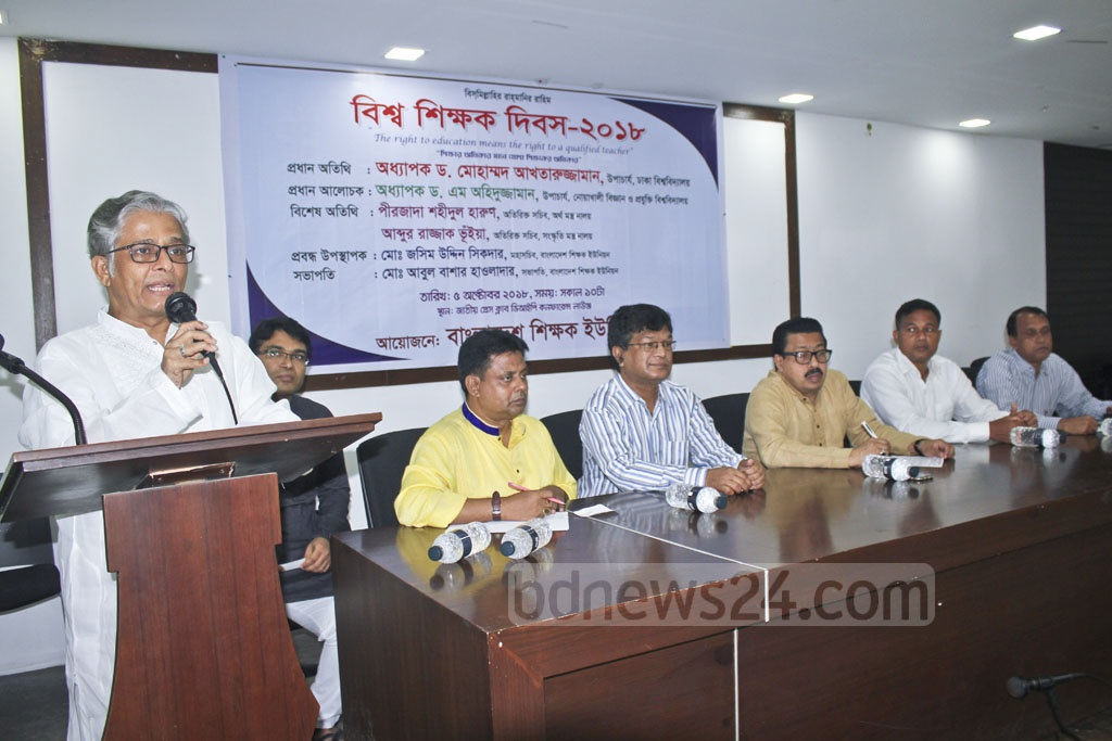 Dhaka University Vice-Chancellor Prof Md Akhtaruzzaman speaks at a discussion organised by the Bangladesh Shikkhok Union to mark World Teachers' Day at the National Press Club on Friday.