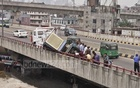 A vehicle carrying a generator crashes on Mayor Mohammad Hanif Flyover in Syedabad on Friday.