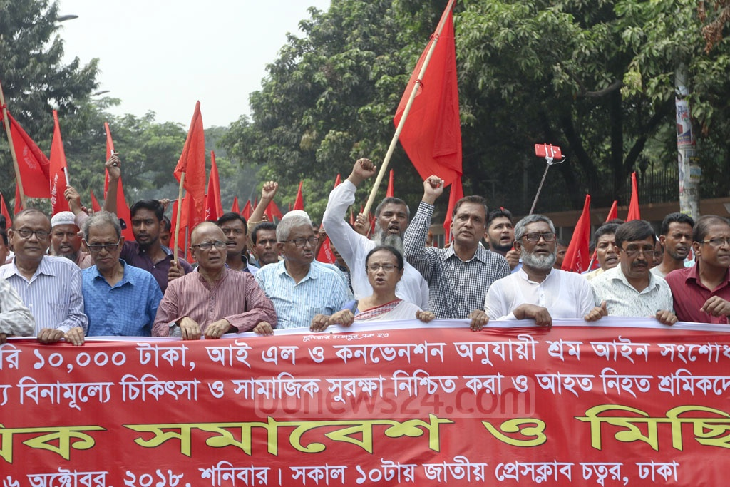 Bangladesh Trade Union Centre takes out a rally in front of the National Press Club in Dhaka on Saturday calling for the authorities to boost monthly minimum wage to Tk 10,000. Photo: Abdullah Al Momin