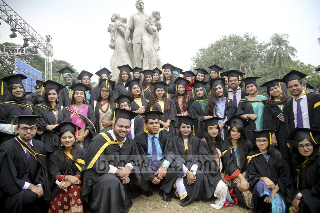 Dhaka University graduates pose with their gowns and caps in front of the Raju Memorial Sculpture on Saturday, the day of their convocation. Photo: Mahmud Zaman Ovi