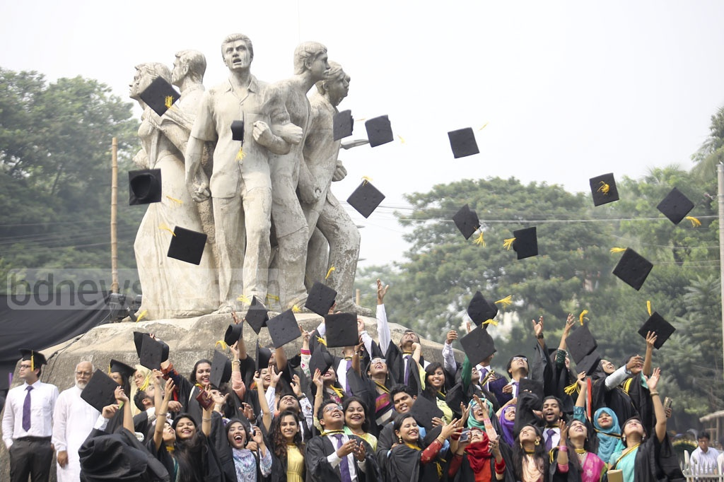Dhaka University graduates throw their caps in the air to celebrate the convocation on Saturday. Photo: Mahmud Zaman Ovi