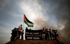 Left-wing activists take part in a protest in solidarity with Palestinians living in Gaza, in front of the Israel-Gaza border, as Palestinians protest on the Gaza side of the border, Israel Oct 5, 2018. REUTERS
