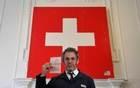 US artist Tom Sachs poses with a Swiss 'passport' as part of his installation 'Swiss Passport Office' at the Frieze Art Fair in London, October 5, 2018. Reuters