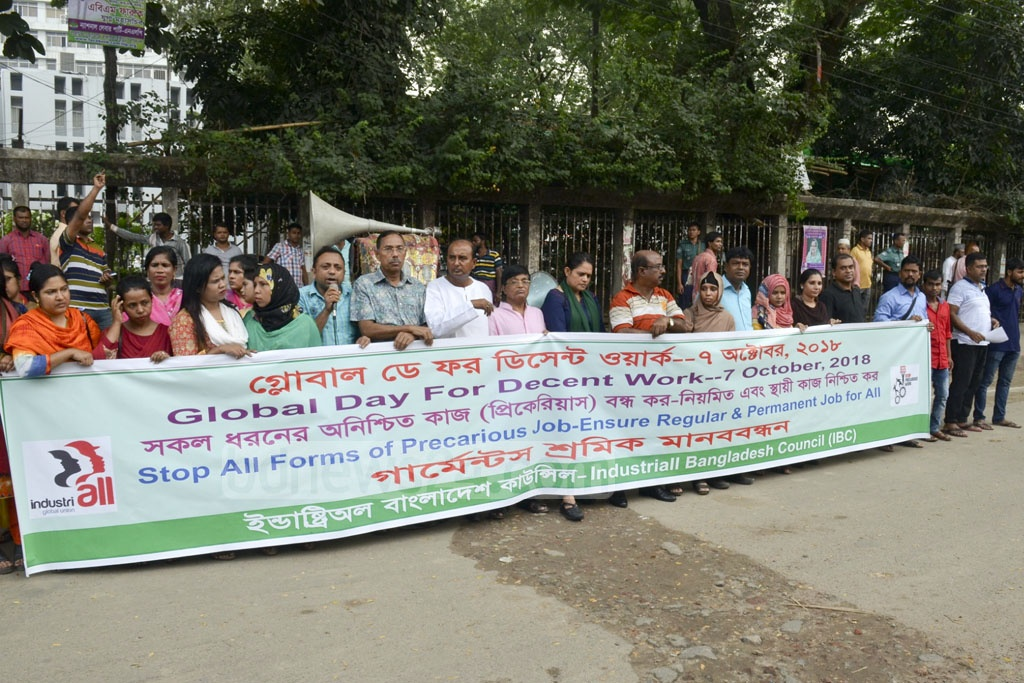 The IndustriALL Bangladesh Council holds a demonstration in front of the National Press Club on Sunday to mark 'Global Day for Decent Work'.
