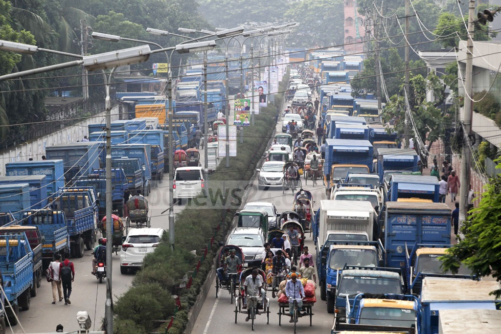 The Union of Truck, Lorry and Covered Van Workers enforced a strike in Dhaka on Sunday in protest against the rise in punishment of drivers for road crashes in the recently passed Road Transport Act The photo was taken from Mayor Annisul Huq Road in Tejgaon's Satrasta area.