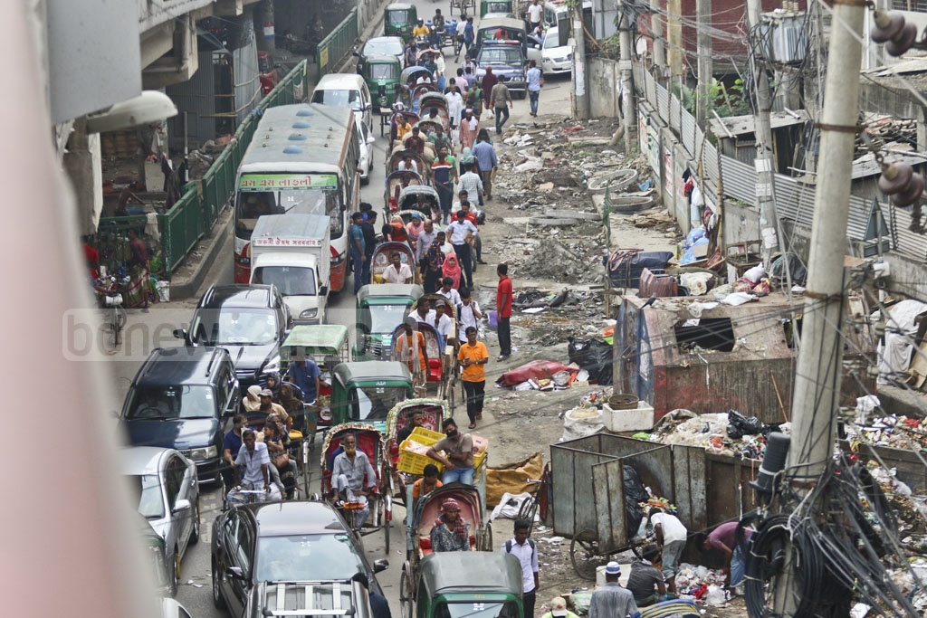 Pedestrians face problems due to dustbins placed on the streets in Dhaka's Mouchak area. Photo: Abdullah Al Momin