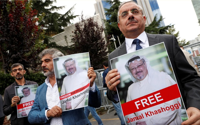Human rights activists and friends of Saudi journalist Khashoggi hold his pictures during a protest outside the Saudi Consulate in Istanbul. Reuters