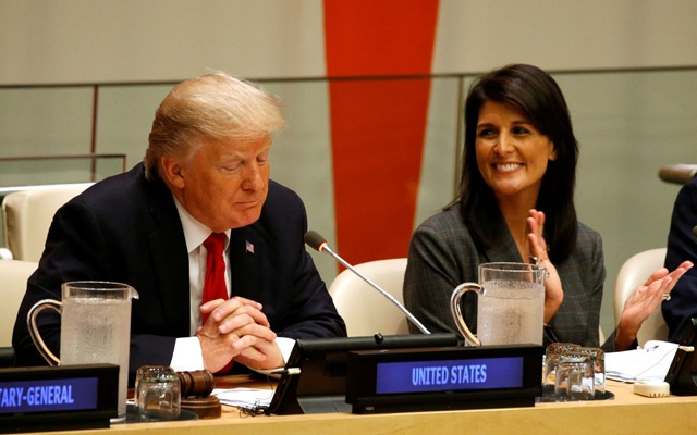 FILE PHOTO: US Ambassador the the UN Nikki Haley applauds as US President Donald Trump speaks during a session on reforming the United Nations at UN Headquarters in New York, US, September 18, 2017. Reuters