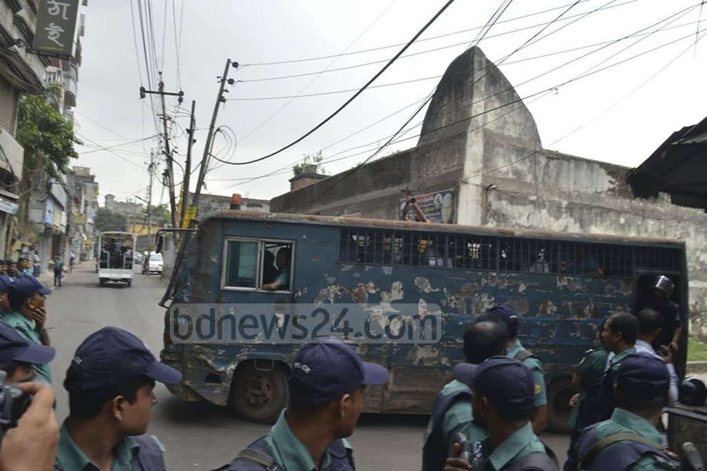 A prison van transports suspects to a Dhaka tribunal on Wednesday, the day of the verdict in a case that involves brazen grenade attacks on an Awami League rally on Bangabandhu Avenue in Dhaka. Photo: Abdullah Al Momin