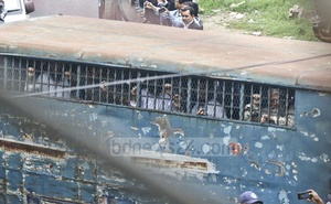 A prison van transports suspects to the Dhaka tribunal.