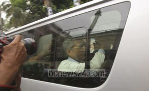 Former state minister for home Lutfozzaman Babar is being taken into custody from the Dhaka tribunal on Wednesday after the announcement of the verdict in the grenade attack case. Photo: Abdullah Al Momin
