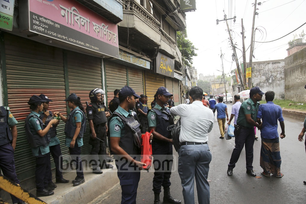 Police check pedestrians who used Old Dhaka's Nazimuddin Road on Wednesday ahead of the verdict on the Aug 21 grenade attack case. Photo: Mahmud Zaman Ovi