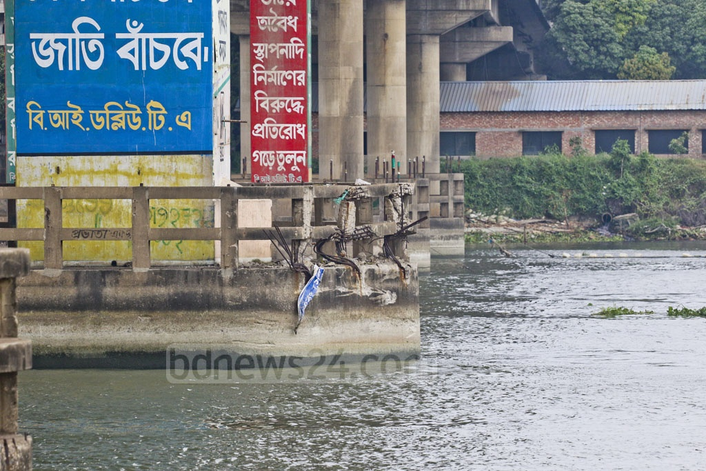 A collision with a launch amid dense fog in winter last year damaged a pillar of the Bangladesh China Friendship Bridge on the Burhiganga River in Dhaka. This photo of the pillar, yet to be repaired after a year, was taken from Postogola area on Friday. Photo: Abdullah Al Momin