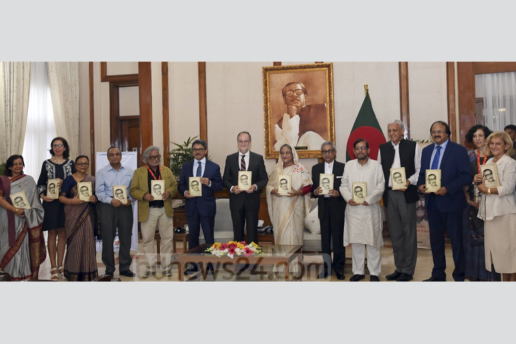 After unveiling 'The Unfinished Memoirs', an autobiography of Bangabandhu Sheikh Mujibur Rahman in Spanish Language, guests pose with the book at the Ganabhaban in Dhaka on Thursday. Photo: PID