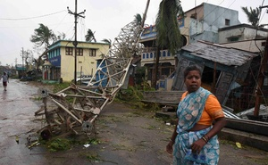 A woman stands next to a damaged communication tower after cyclone Titli hit in Srikakulam district in the southern state of Andhra Pradesh, India, October 11, 2018. Reuters