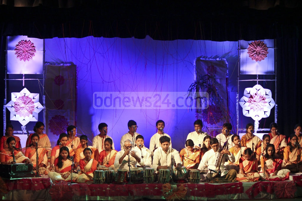 Singers performing at the Sharat Utsab or autumn festival at the Chhayanaut Auditorium in Dhaka on Friday.