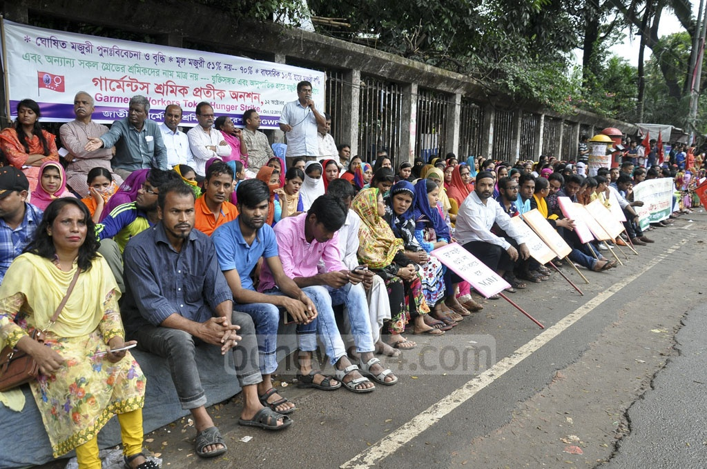 Bangladesh Garment Sramik Federation stages a token hunger strike in front of the National Press Club on Friday for pressing home its demands, including a wage hike for workers.