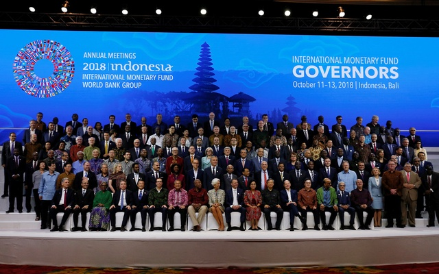 IMF Managing Director Christine Lagarde (CF), Central Bank governors and finance ministers pose for a group photo at the International Monetary Fund - World Bank Group Annual Meeting 2018 in Nusa Dua, Bali, Indonesia Oct 13, 2018. REUTERS
