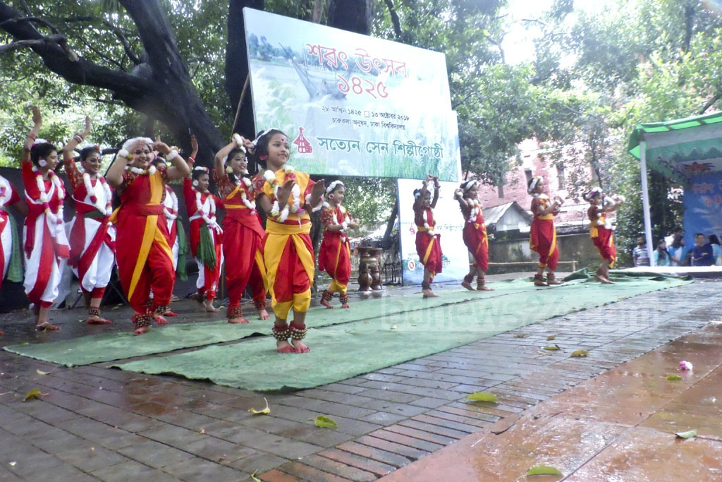 Children perform during autumn celebrations at the Institute of Fine Arts in Dhaka on Saturday.