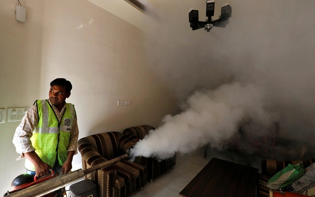 A public health department worker fumigates inside a house to prevent the spread of mosquito borne diseases in New Delhi, India, October 9, 2018. Reuters