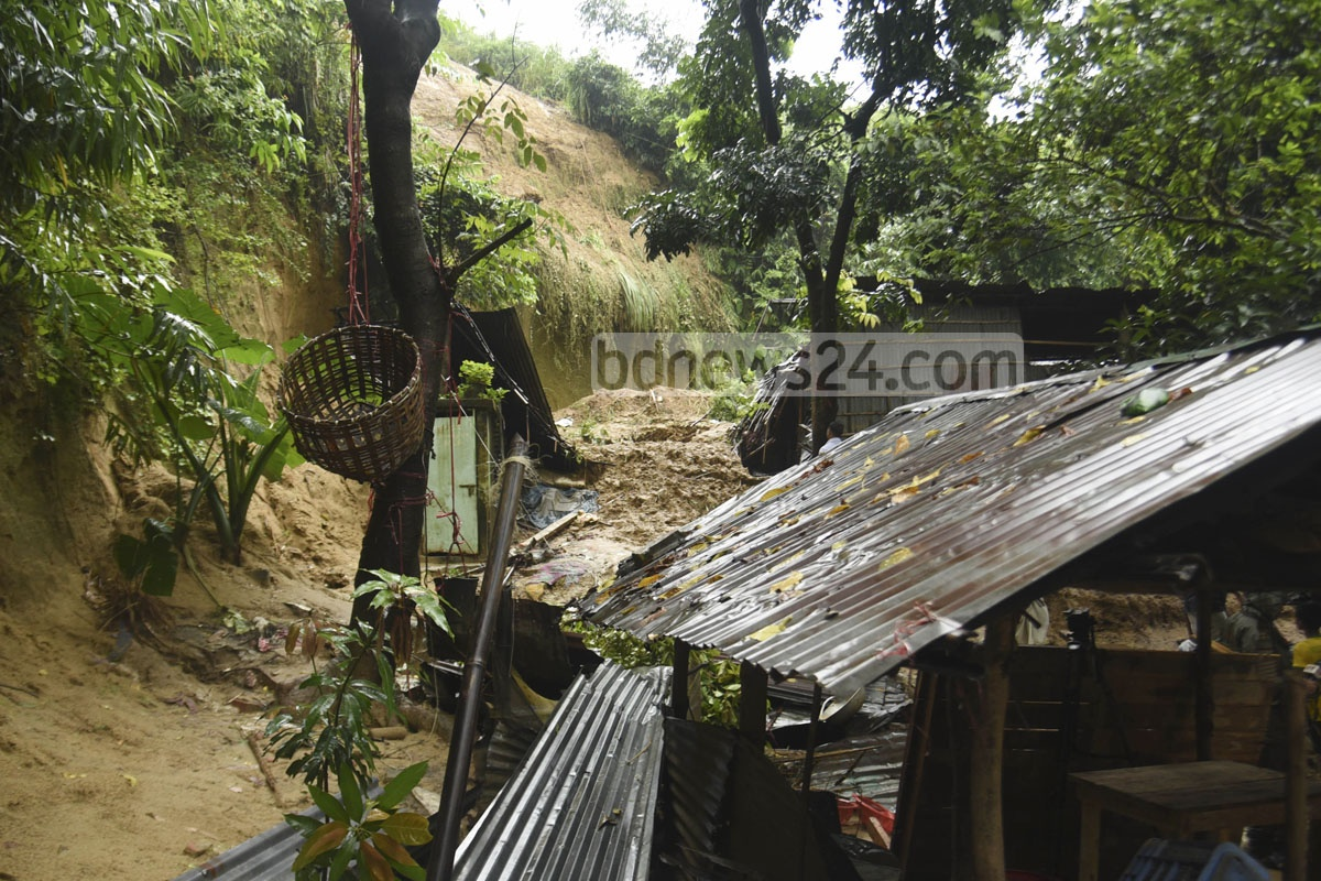 Three members of a family were killed after heavy rain caused a landslide in Akbar Shah Thana's Firoz Shah Colony. Photo: Suman Babu