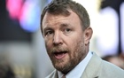 FILE PHOTO: Director Guy Ritchie arrives at a movie premiere, London, Britain May 10, 2017. Reuters