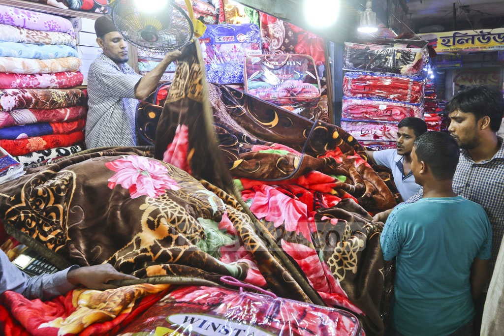 The wholesale markets of Bangabazar in Dhaka buzzing withtraders of blankets ahead of the winter on Tuesday. Photo: Abdullah Al Momin