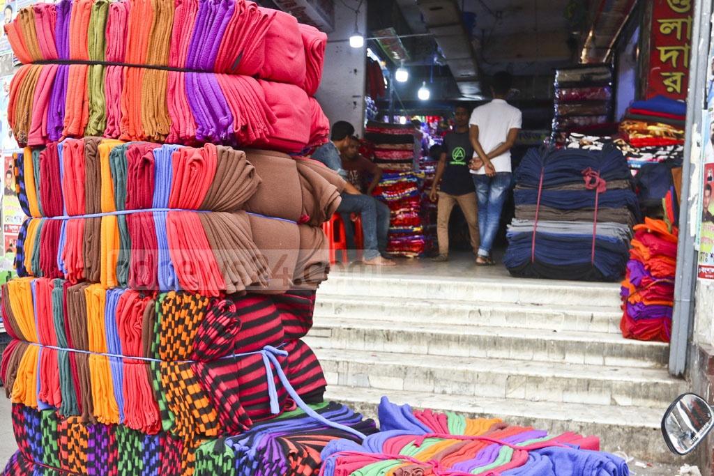 Shopkeepers sorting colourful blankets at the whalesale markets of Bangabazar in Dhaka as sale rises on Tuesday ahead of the winter. Photo: Abdullah Al Momin
