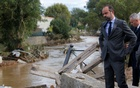 French Prime Minister Edouard Philippe, who is also interim Interior Minister, reacts as he inspects the damage after flash floods hit the south-western Aude district of France after several months' worth of rain fell in just a few hours overnight, in Villegailhenc, France, Oct 15, 2018. REUTERS