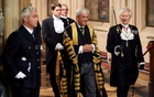 FILE PHOTO: Gentleman Usher of the Black Rod David Leakey (R) walks with Speaker of the House of Commons John Bercow (L) across the Central Lobby of the Palace of Westminster during the State Opening of Parliament in central London, Britain June 21, 2017. Reuters