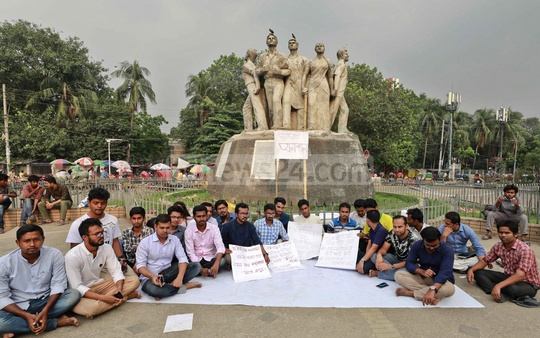 Akhtar Hossen, at the centre in white punjabi, a Dhaka University law student, has started a hunger strike at the foot of the Raju Sculpture in protest against the alleged leak of 'Gha' unit admission test question paper. Quota reform protesters expressed solidarity with Akhtar on Wednesday.
