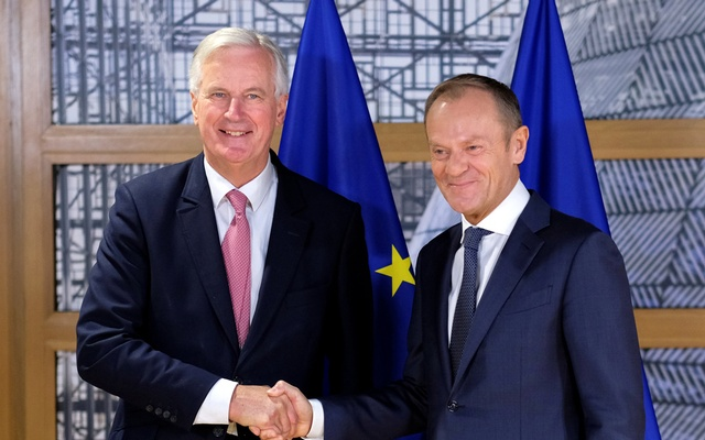 The European Union's Brexit negotiator Michel Barnier is welcomed by European Council President Donald Tusk prior to a meeting in Brussels Belgium Oct 16 2018. Olivier Hoslet  Pool via Reuters