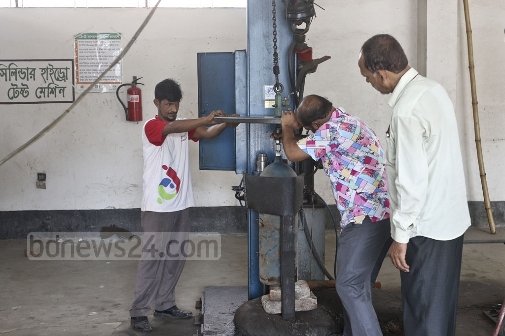 Technicians working at the CNG Conversion and Testing Workshop of the state-owned Rupantarita Prakritik Gas Company Limited at Rayerbagh in Dhaka on Wednesday. Photo: Abdullah Al Momin