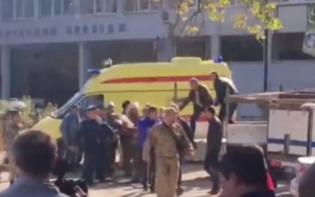 Emergency services carry an injured victim of a blast at at a college in the port city of Kerch, Crime