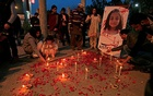 Candles and earthen lamps are lit to condemn the rape and murder of 7-year-old girl Zainab Ansari in Kasur, during a candlelight vigil in Islamabad, Pakistan January 11, 2018. REUTERS