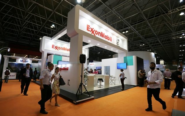 File Photo: People walk near the booth of the Exxon Mobil Corp at the Rio Oil and Gas Expo and Conference in Rio de Janeiro, Brazil Sept 24, 2018. Reuters
