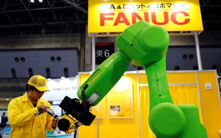 A staff member of FANUC checks its collaborative robot CR-35iA at World Robot Summit in Tokyo, Japan, Oct 17, 2018. Reuters