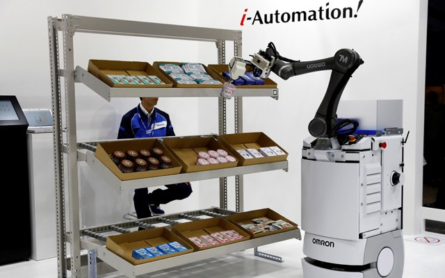 OMRON's TM series of collaborative robot is pictured during its demonstration at World Robot Summit in Tokyo, Japan, Oct 17, 2018. Reuters