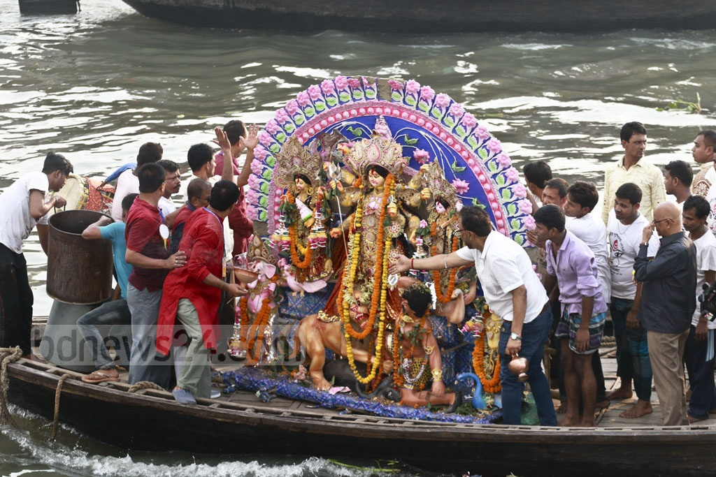 Hindu devotees bidding goodbye to the goddess Durga through immersion of her idols in the Burhiganga River in Dhaka's Waizghat pier on Friday. Photo: Abdullah Al Momin