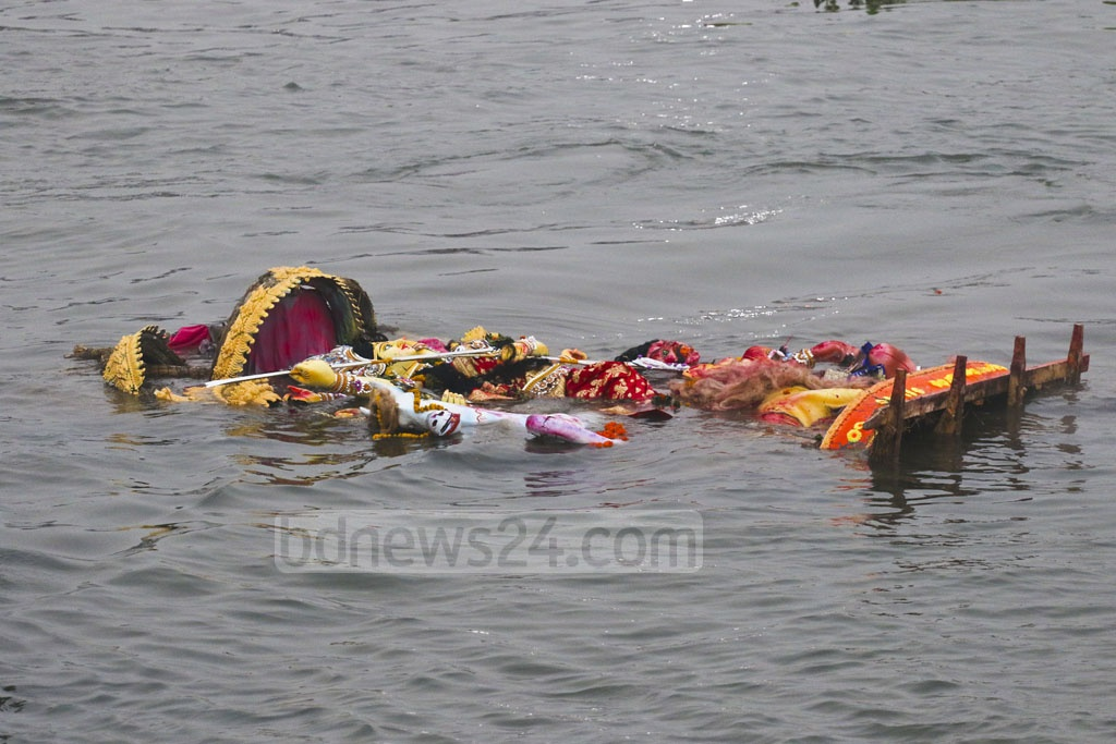 An idol of the goddess Durga floats after immersion in the Burhiganga River in Dhaka's Waizghat pier, marking the end of the largest festival of the Hindus in Bangladesh on Friday. Photo: Abdullah Al Momin