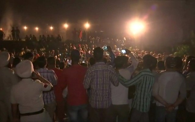 People gather at the train accident site in Amritsar, India October 19, 2018 in this still image from video provided by Reuters TV. ANI News via REUTERS