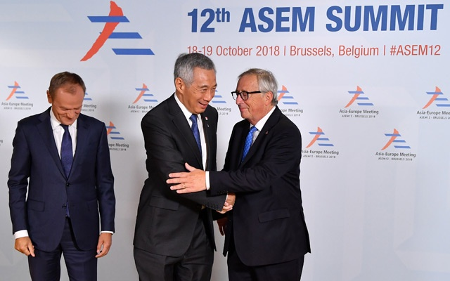 President of the European Commission Jean-Claude Juncker and European Council President Donald Tusk welcome Singapore's Prime Minister Lee Hsien Loong to the ASEM leaders summit in Brussels, Belgium October 18, 2018. Reuters