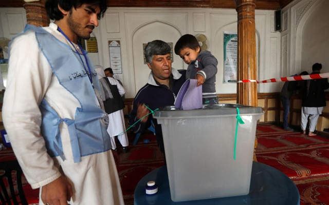 An Afghan man casts his vote during parliamentary elections, at a polling station in Kabul, Afghanistan, Oct 20, 2018. REUTERS