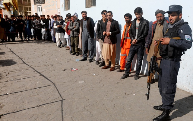 Afghan men line up to cast their votes during parliamentary elections at a polling station in Kabul, Afghanistan, Oct 20, 2018. REUTERS