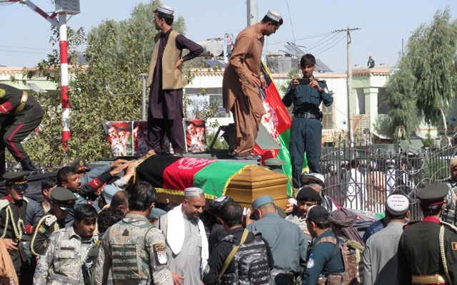 Afghan National Police honor guards carry the coffin of General Abdul Razeq, the Kandahar police commander, who was killed in yesterday's attack, during a burial ceremony in Kandahar province, Afghanistan Oct 19, 2018. REUTERS