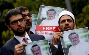 File Photo: Human rights activists and friends of Saudi journalist Jamal Khashoggi hold his pictures during a protest outside the Saudi Consulate in Istanbul, Turkey Oct 8, 2018. REUTERS/Murad Sezer