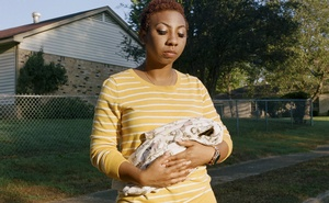 Chasisty Bee holds a baby blanket in memory of her 2014 miscarriage, in Memphis, Tenn, Oct 8, 2018. In 2014, while Chasisty Bee was pregnant, her supervisors at the Verizon warehouse in Memphis refused to grant her request for light duty. One day, she collapsed at work. She later miscarried. The New York Times