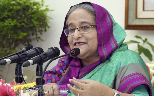 Prime Minister Sheikh Hasina briefing the media about her recent Saudi Arabia tour and other issues at a Ganabhaban press conference in the capital on Monday. Photo: PID