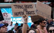 FILE PHOTO: People protest US President Donald Trump's announcement that he plans to reinstate a ban on transgender individuals from serving in any capacity in the US military, in Times Square, in New York City, New York, US, July 26, 2017. Reuters